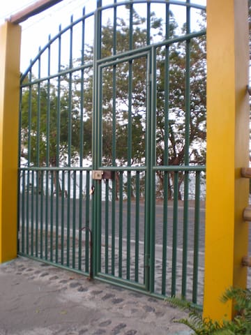 Gated entrance and fenced property with off-street parking.