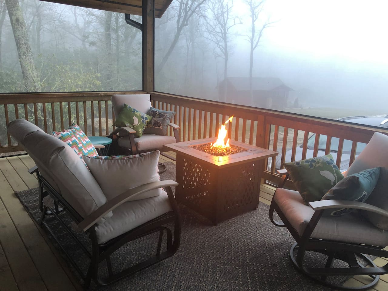 Outdoor Propane Fire Table in screened in porch.