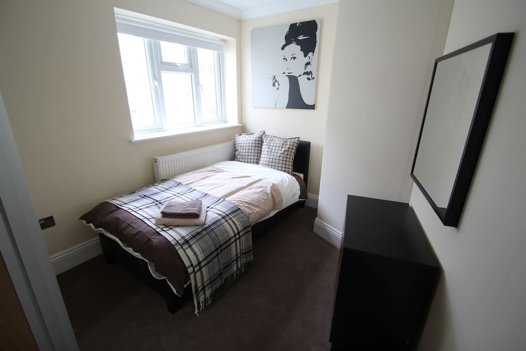 Modern bed & large wardrobes giving plenty of storage space. New bedding provided.