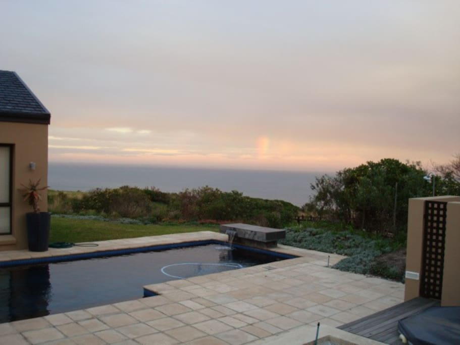 Protected pool and entertainment area has sea views