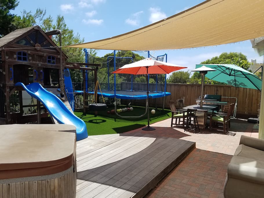 Backyard. Large gas grill. Hot-tub. 10ft Trampoline. Playhouse Slide + Swings.