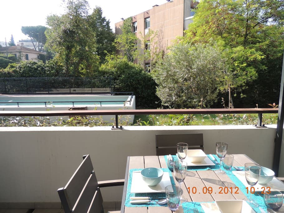 Dining on the terrace overlooking the gardens and pool