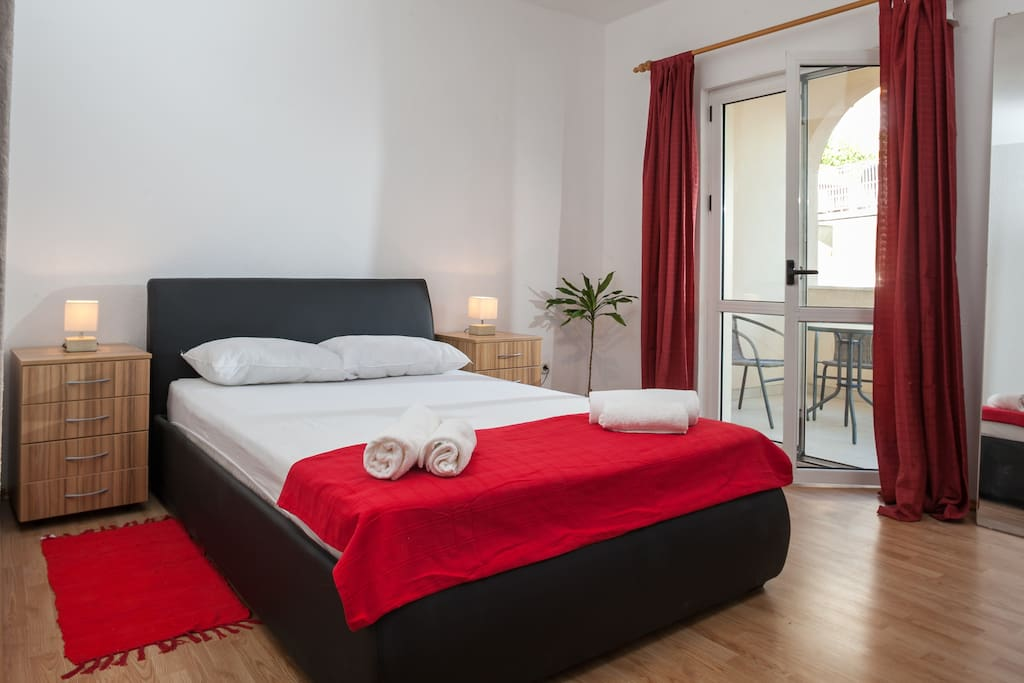 room with smaller bed