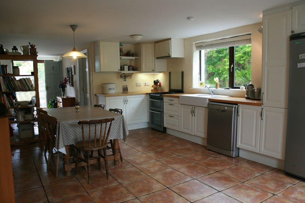 Our kitchen with dishwasher and gas cooker. There's a utility room with freezer, washing machine & dryer.