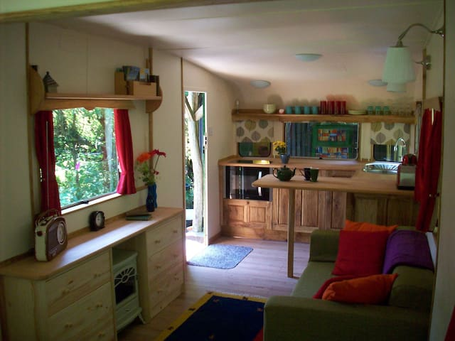 The caravan has a lovely hand-built and well-equipped galley kitchen with combi oven, and underfloor heating!