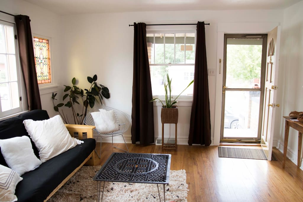 Bright living room with a futon that pulls out into a full bed - the apartment sleeps four comfortably