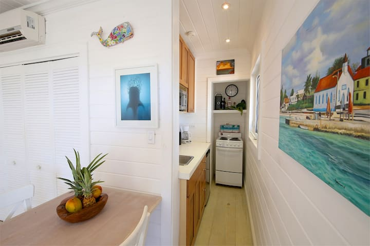 Kitchen table for 2, with view into galley-style kitchenette