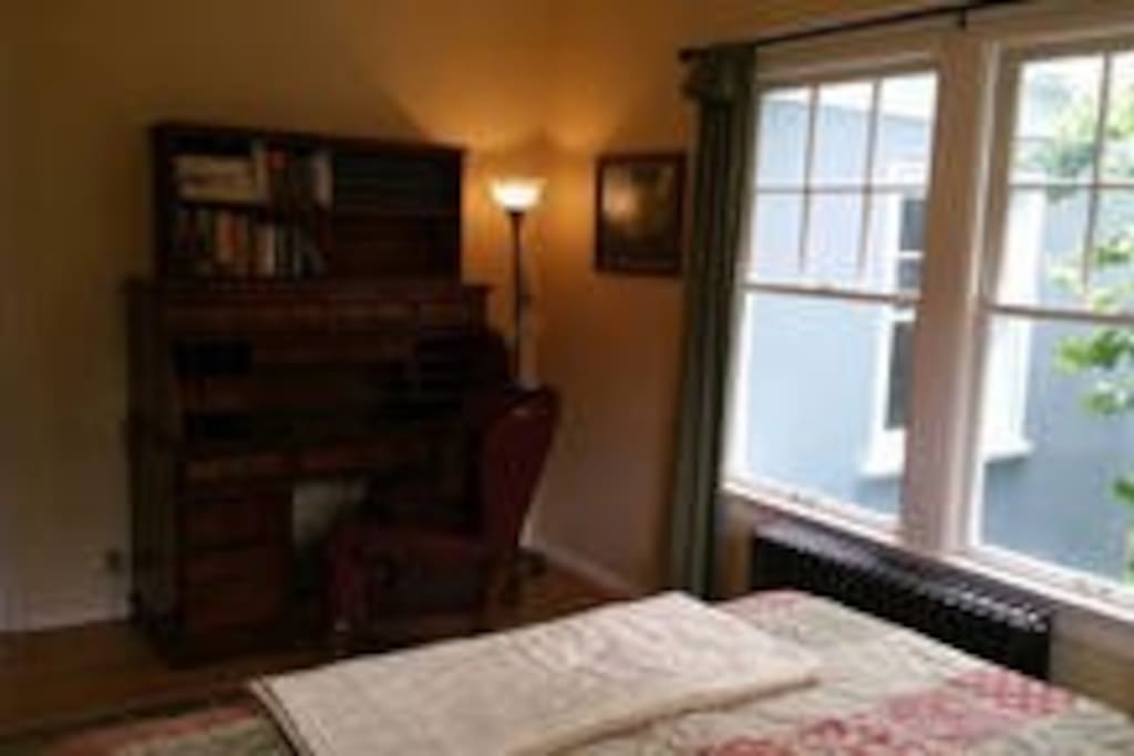 Large writing desk with comfy reading chair.