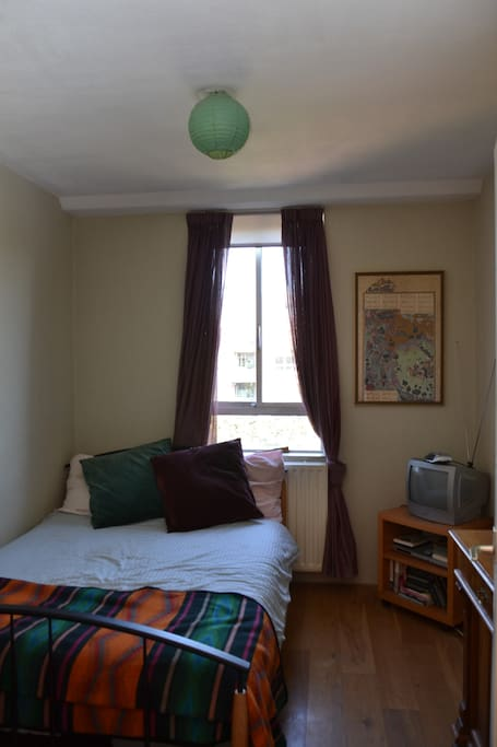 Guest room with double bed, power converter for American appliances.