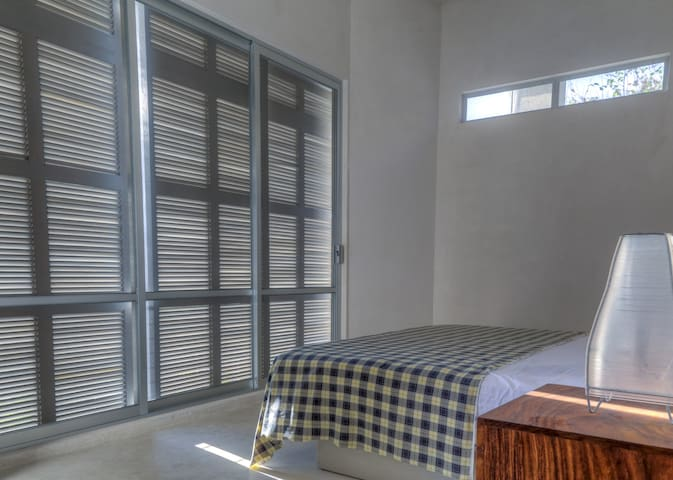 Each bedroom on the garden level and the catwalk levels have screens to allow breezes in and no need for air conditioning.  The shutter system on the screened doors open and close to allow as much or as little light in as you like.