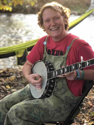 This guest loved having a banjo lesson  by the creek with Allie.