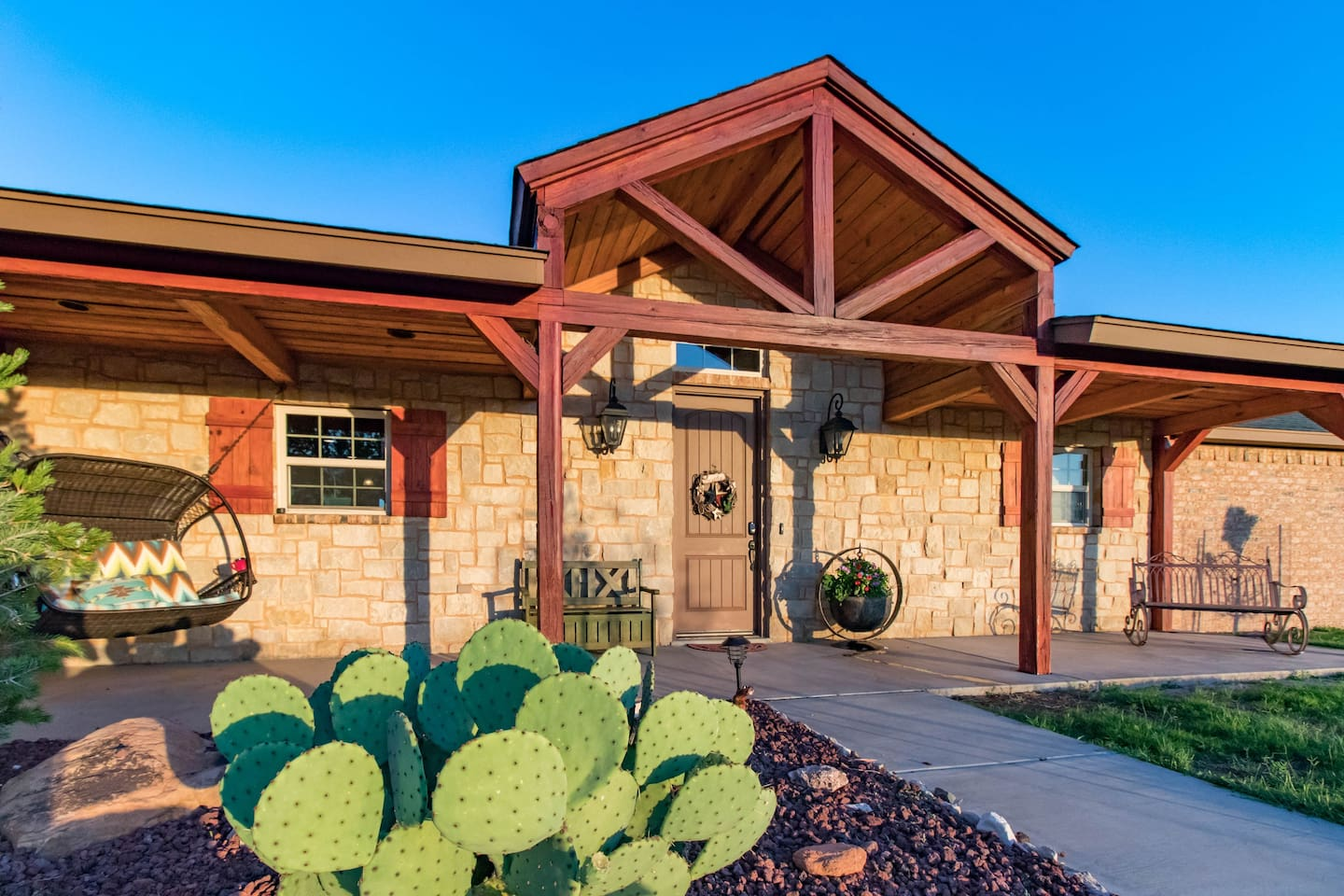 Welcome to Nocona Lodge. Front porch swings for all to enjoy morning wildlife and evening sunsets.