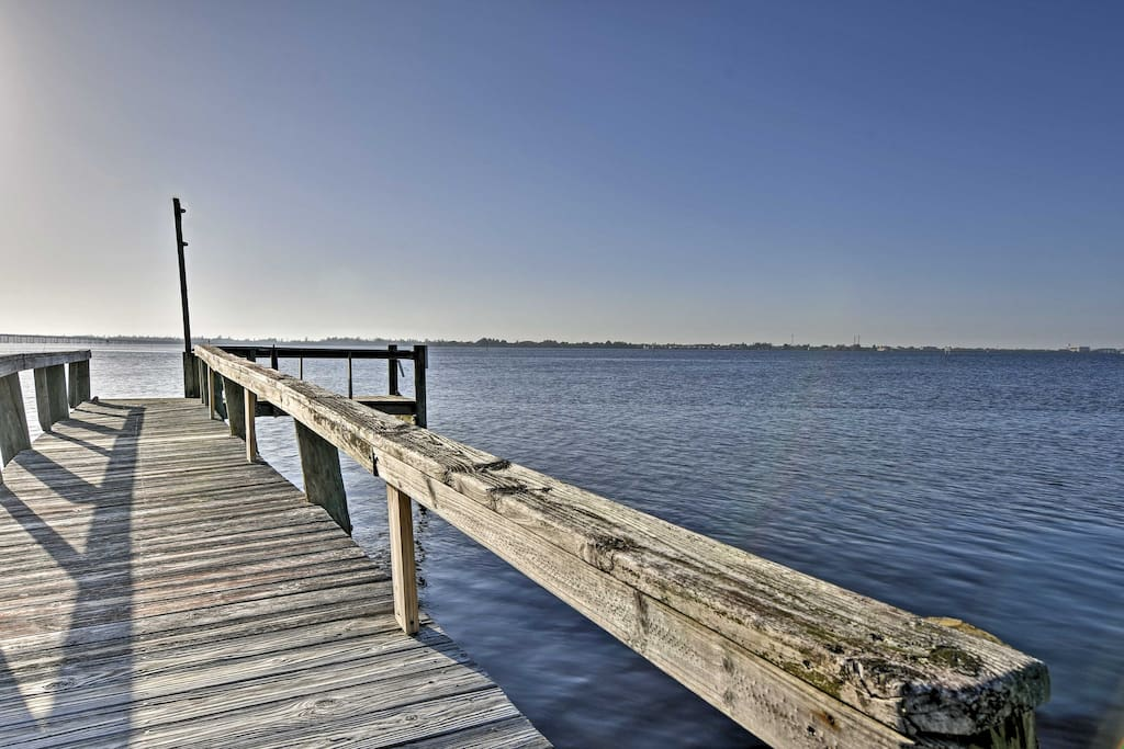 Admire the spot where the Peace River flows into Charlotte Harbor from the dock.