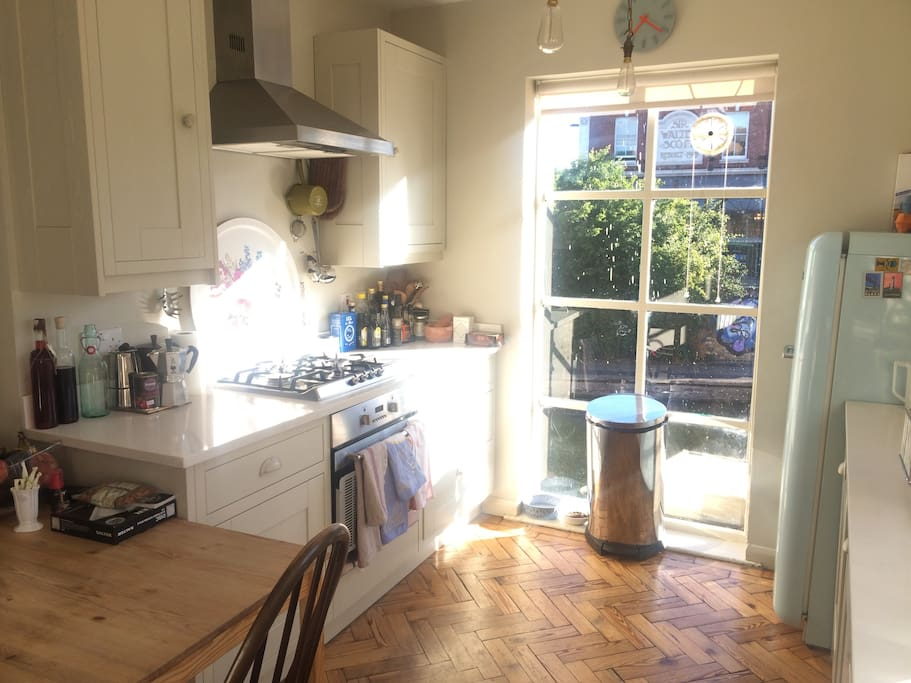 Huge window in the kitchen with full amenities including a SMEG fridge and all appliances