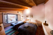 Single beds that become Kingsize bed together, patio access.