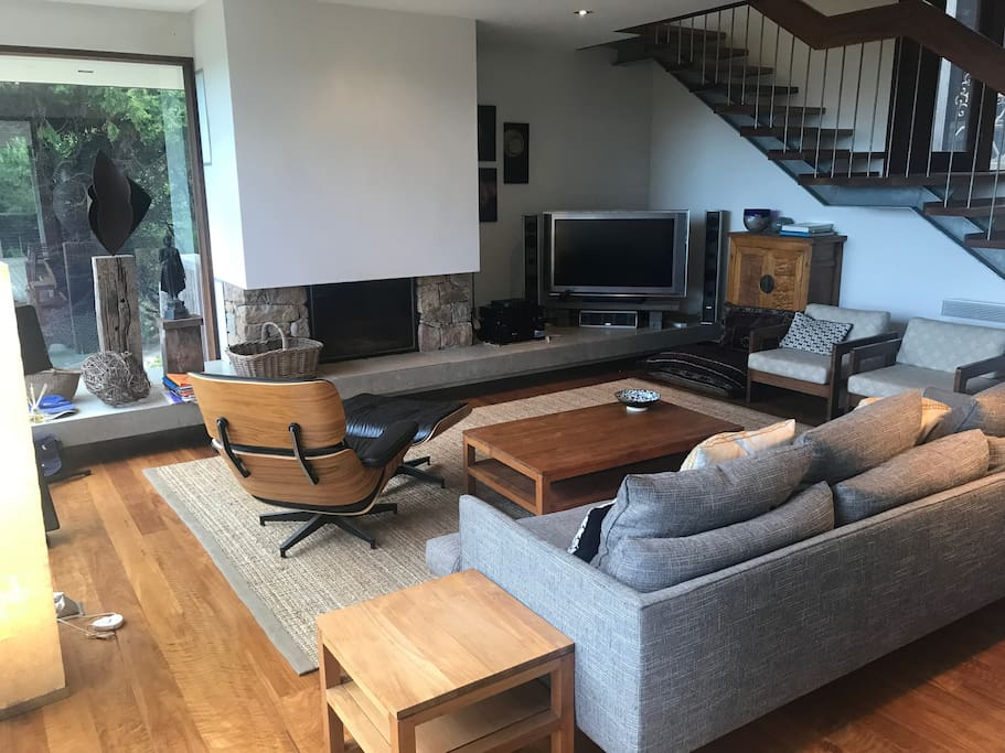 Living room- open fire, large windows, sliding doors to large deck