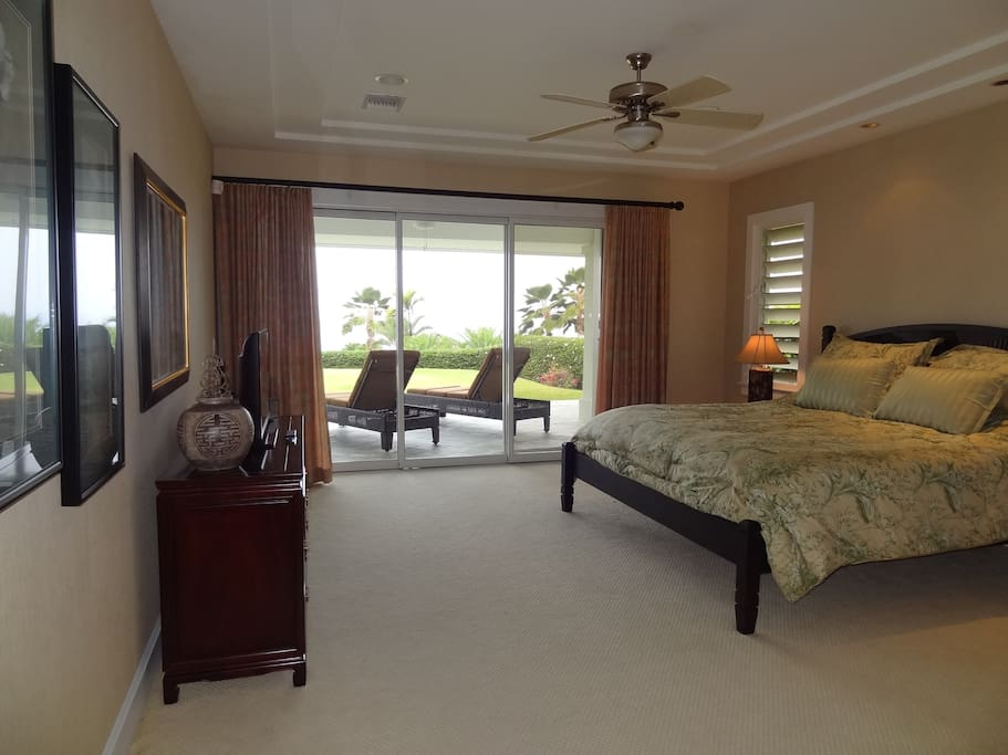 Huge master bedroom with a wall of disappearing sliders with screens for open air nights.