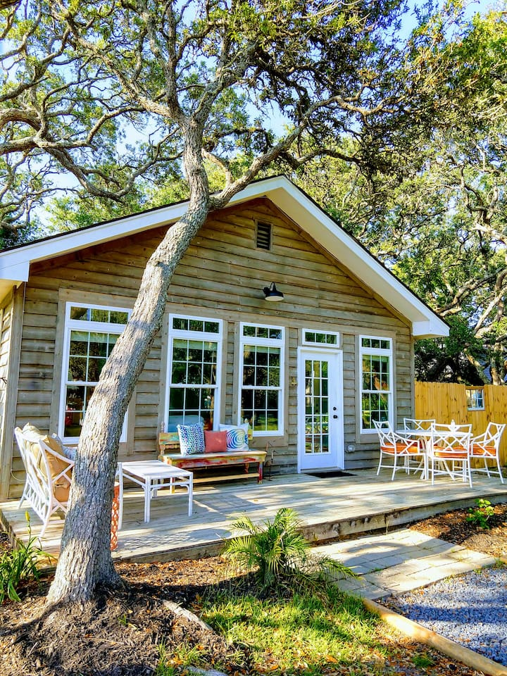Our cottage by the sea is nestled under beautiful live oak trees just steps away from the ocean and close to Oak Island restaurants, shopping and entertainment.
