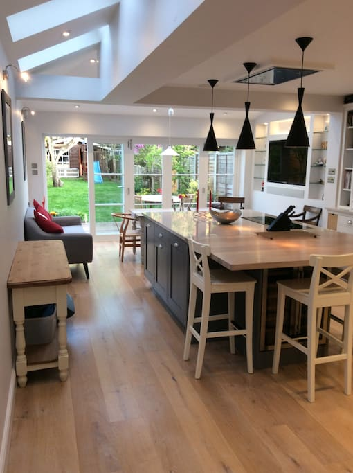Fully equipped kitchen opening to secluded garden