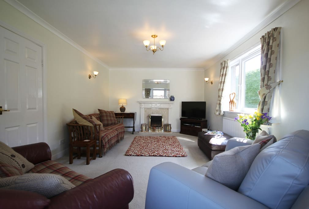 Bright, airy lounge with Sky TV, cosy fireplace and seating for 8.