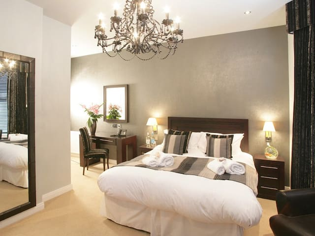 Stylish and spacious large king double room with all the conveniences you would expect from a Boutique Hotel.
