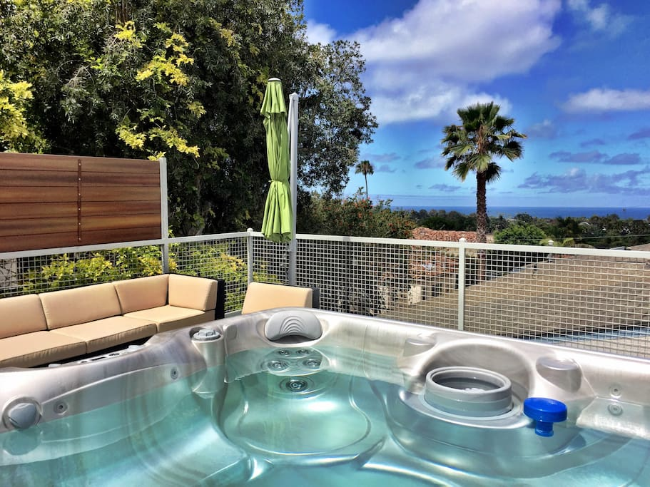 Our rooftop hot tub and ocean views. Seating area as well.