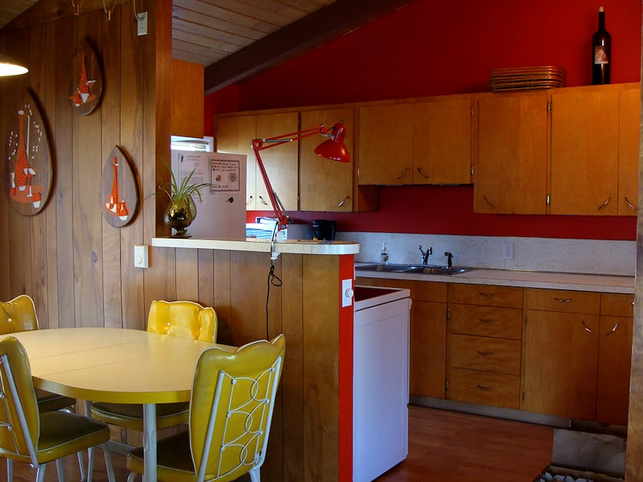 wood cabinetry and primary colors truly set off the 60's home accessories.