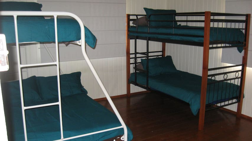 Large bedroom has double bed plus bunks, aircon and built in robe