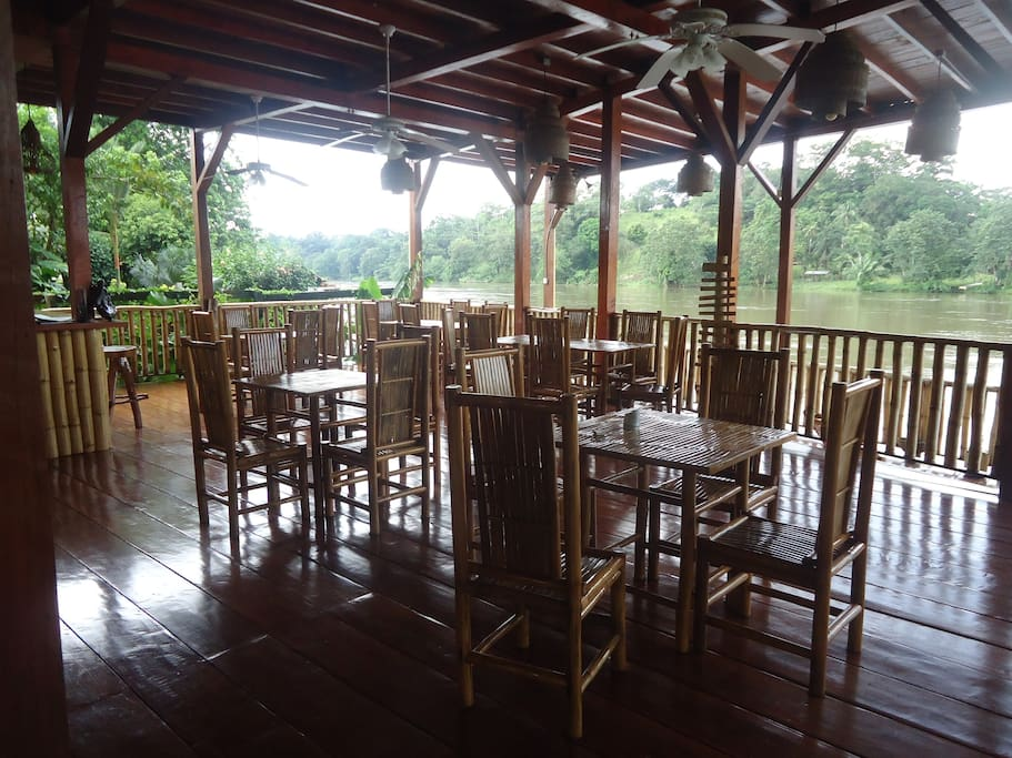 Restaurant dining area overlooking the river.