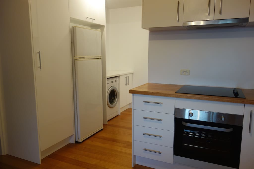 Large fridge, washing machine and outdoor line for your convenience.