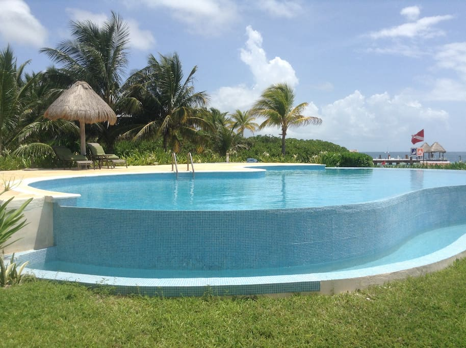 This is the infinity pool that over looks the ocean the sandy beach, taking in the sun the breeze and the tranquility of the sound of the ocean.