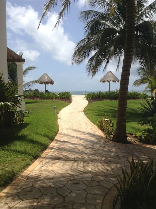 pathway from our villa to pool and beach access, stairs on the right hand side to gate access