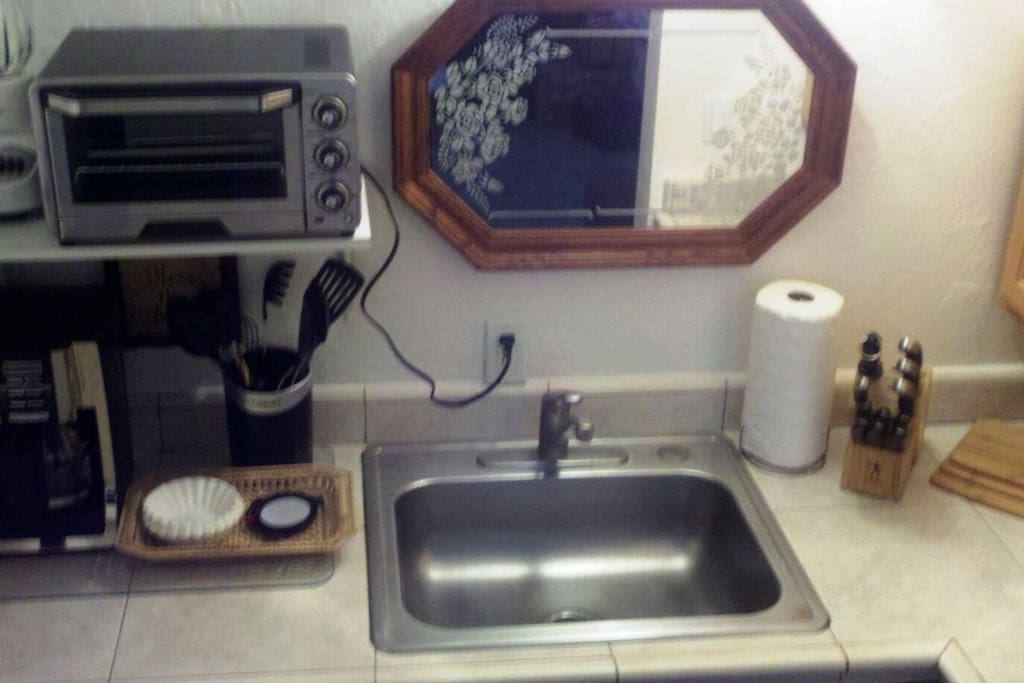 Kitchenette, no oven, sink, toaster oven and coffee pot.