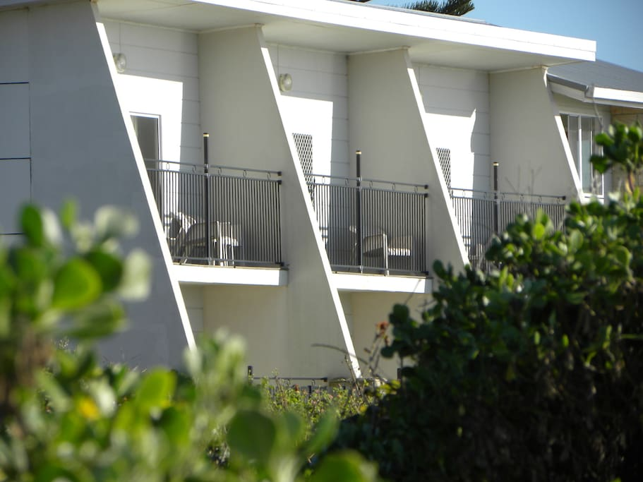 Relax on your private balcony and watch the whales and the dolphins swim by. 20 steps to the sand!