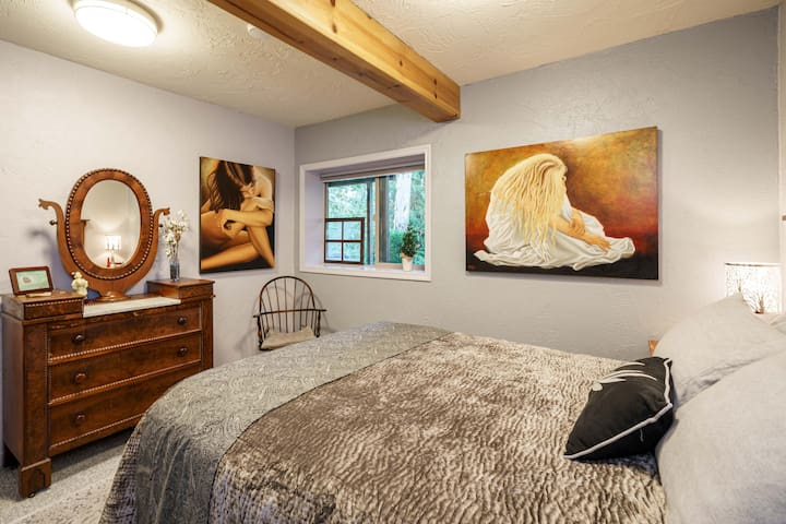 This is the master bedroom.  The queen mattress is moderately firm, the pillows all feather, and the room is individually heated for your comfort.  The art is masterful, original, local and for sale by the artists.