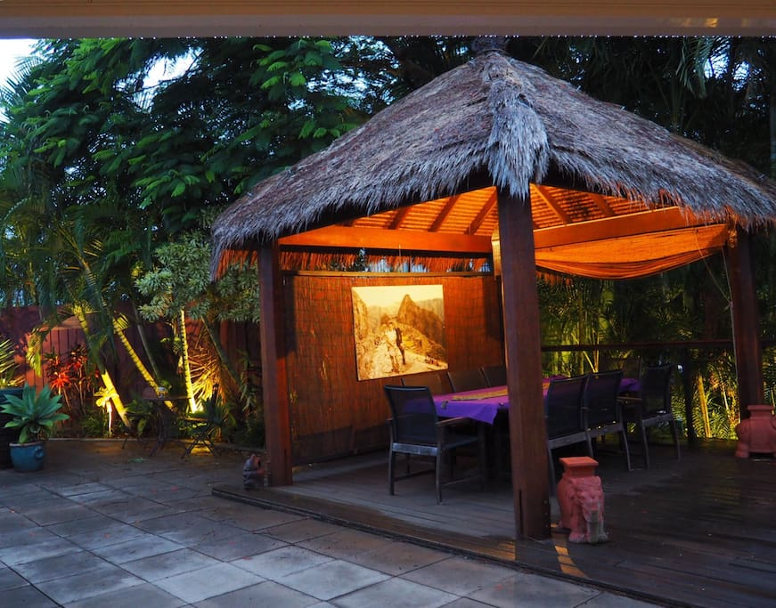 The Bali hut surrounded my palms at night. Perfect for a relaxing dinner.