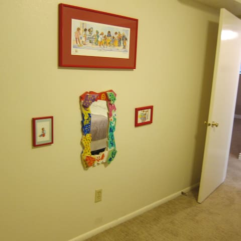 Bedroom 3 with kid friendly art