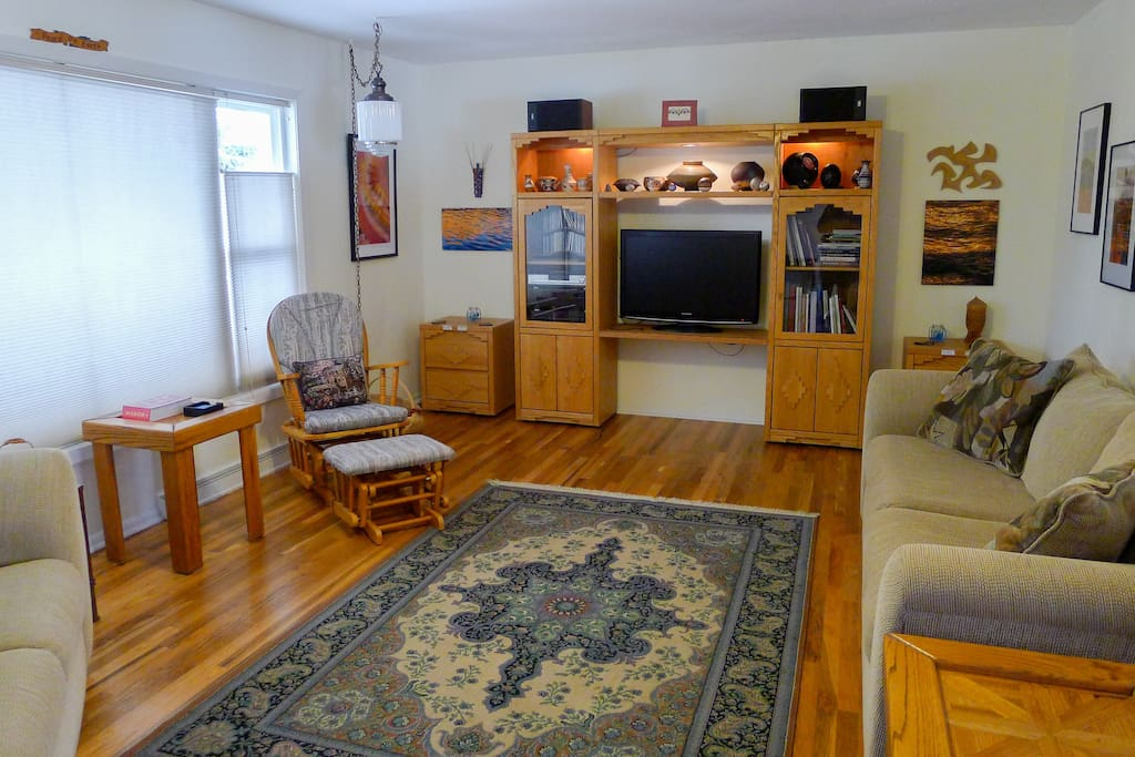 Recently redone wood floors and entertainment center to enjoy in the living room.