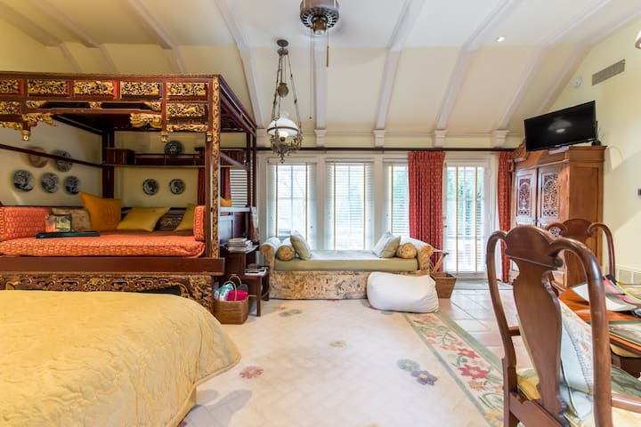 Guesthouse interior includes a gorgeous, authentic Chinese day bed for reading, writing, and relaxation.