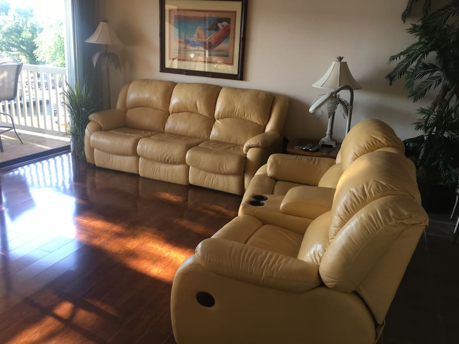 Fully updated living with leather sleeper sofa to sleep a total of 6.