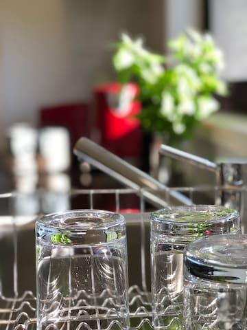 Dish rack and kitchen fixture closeup
