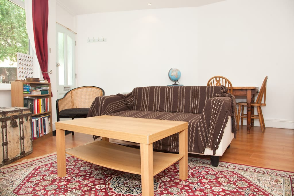 Sofa and coffee table. The dining table is at the back