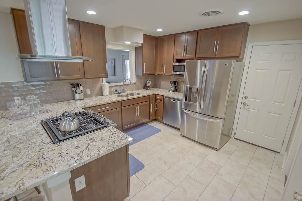 New kitchen with stainless appliances & granite counters