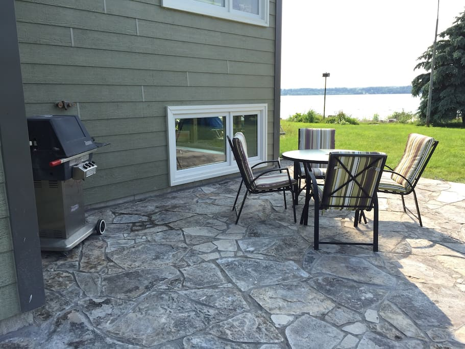 BBQ and patio set on private flagstone patio
