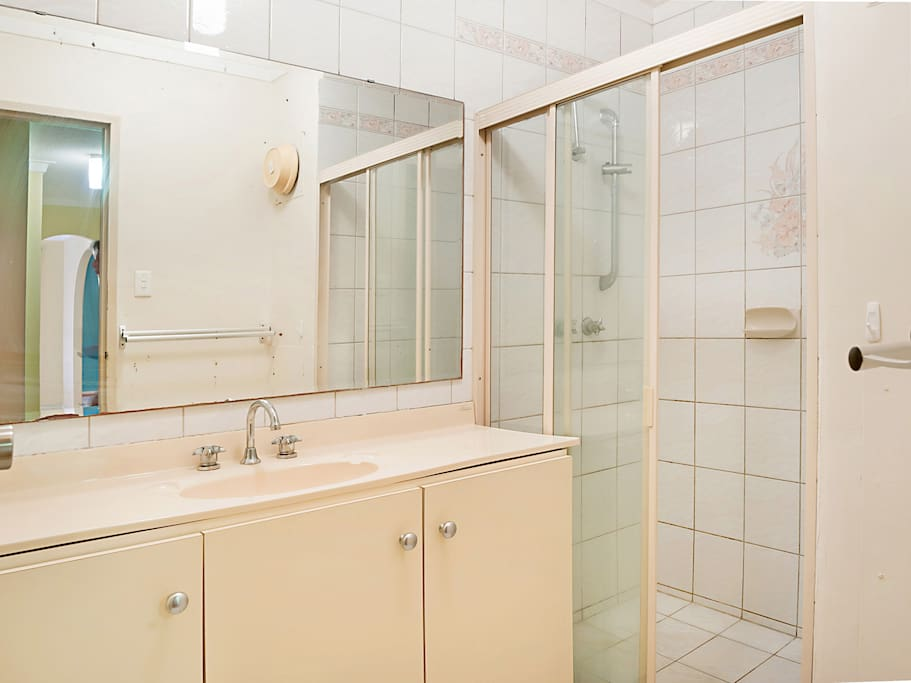 Bathroom with separate toilet and shower