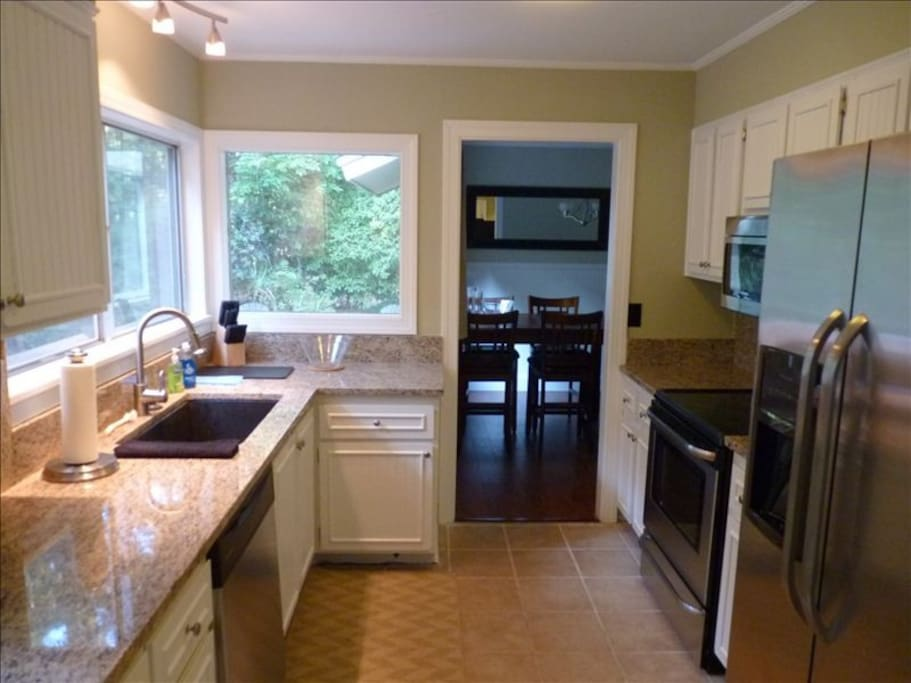Fully appointed Kitchen with granite counter tops and sink