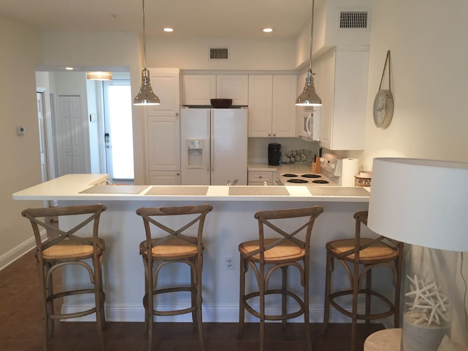Kitchen has plenty of storage, clean appliances and breakfast bar