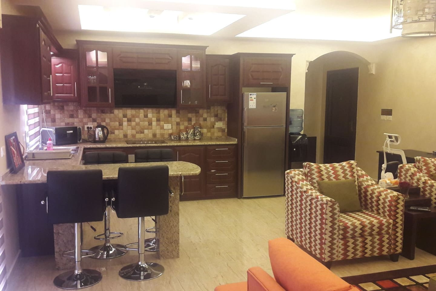 The kitchen is opened to the living room with full house wear & high end appliances (Fridge, microwave, kettle, hood, cook top, oven, cooler, toaster), We provide you with pure drinking water.