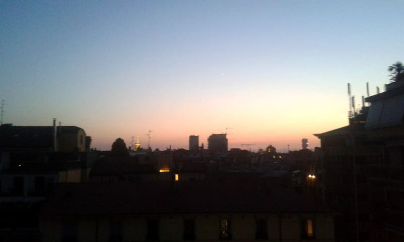 View from the balcony on Milan's rooftops during sunset
