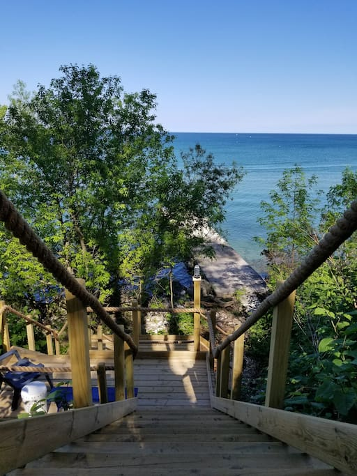 Private steps to a private pier that allows you to walk right into Lake Michigan. Towels provided at the top!